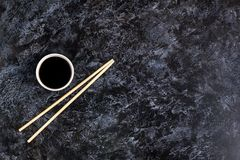 Japanese sushi chopsticks and soy sauce on black background. Top view with copyspace. Japanese sushi chopsticks and soy sauce on black stone background. Top view stock photos