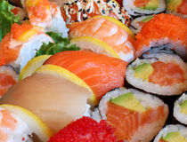 Japanese Sushi. Close up with a variety of delicious prepared fresh raw fish and seafood as salmon shrimp and caviar with rice and vegetables as a food and royalty free stock photos