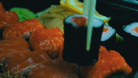 Japanese sushi cuisine with fresh raw fish.Japanese dish consisting of rice, salmon or tuna,shrimp and fish eggs soaked. Macro Japanese sushi cuisine with fresh stock video footage