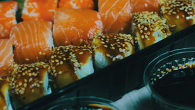 Japanese sushi cuisine with fresh raw fish.Japanese dish consisting of rice, salmon or tuna,shrimp and fish eggs soaked. Macro Japanese sushi cuisine with fresh stock footage