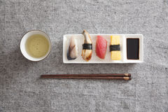 Japanese Sushi - Egg, Tuna, Eel, Swordfish, Green tea Stock Photos
