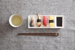 Japanese Sushi - Egg, Tuna, Eel, Swordfish, Green tea. Japanese Sushi -- Egg, Tuna, Eel, Swordfish, Green tea Stock Photos