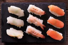 Japanese sushi food selection black slate platter row. Japanese sushi food selection black slate platter Royalty Free Stock Images