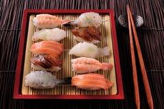 Japanese sushi food various assortment red bamboo tray chopsticks Stock Image