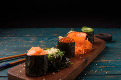 Japanese sushi and garnish. On a dark background Stock Photos