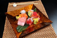 Japanese sushi on a gold plate Royalty Free Stock Image