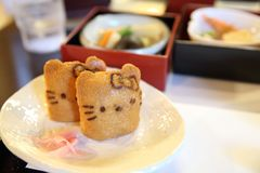 Japanese sushi Inari sushi, fried bean-curd stuffed with boiled rice kitty cat. On a plate stock photo