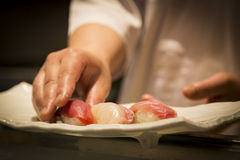 Japanese sushi in the making. Make japanese sushi fish raw food cuisine asia asian Royalty Free Stock Images