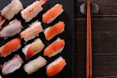 Japanese sushi platter various different with chopsticks top view. Japanese sushi platter various different with chopsticks Royalty Free Stock Image