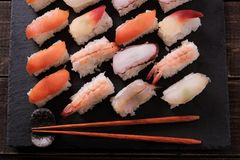 Japanese sushi platter various different with chopsticks top view. Japanese sushi platter various different with chopsticks Stock Photos
