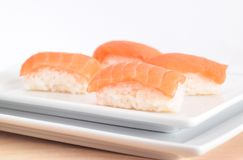 Japanese sushi with raw salmon. Four japanese sushi with slice of raw salmon and rice Stock Photos