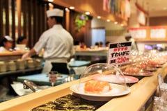 Japanese sushi restaurant with sushi on foreground Royalty Free Stock Photography