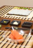 Japanese sushi with rice ready to roll on a table Royalty Free Stock Images