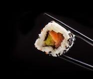Japanese sushi roll on black background Royalty Free Stock Image