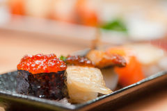 Japanese sushi. Roll made of Smoked fish and roe. Royalty Free Stock Image
