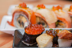 Japanese sushi. Roll made of Smoked fish and roe. Royalty Free Stock Photography