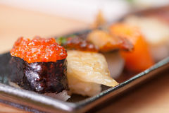 Japanese sushi. Roll made of Smoked fish and roe. Royalty Free Stock Photos