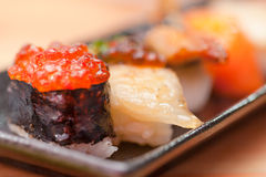 Japanese sushi. Roll made of Smoked fish and roe. Stock Photo