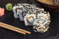Japanese sushi roll philadelphia on black stone. Royalty Free Stock Photos