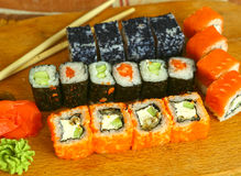 Japanese sushi roll set on wooden kitchen board Stock Photography