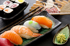 Japanese Sushi and Rolls. As closeup on a traditional plate Stock Photo