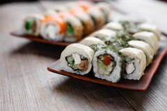 Japanese sushi rolls with assorted fillings set Stock Images