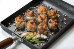 Japanese sushi rolls on a black frying pan. close view.  royalty free stock images