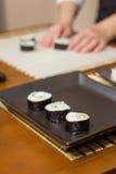 Japanese sushi rolls on a black rectangular tray Stock Photo