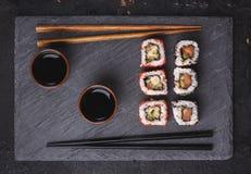 Japanese sushi rolls on black stone plate Stock Photo