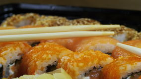 Japanese Sushi Rolls with Chopsticks Rotates stock footage