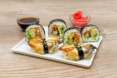 Japanese sushi and rolls on a white plate Royalty Free Stock Images