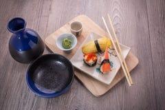 Japanese sushi and sake set. Japanese sushi set on old wood background Stock Photo