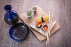 Japanese sushi and sake set. Japanese sushi set on old wood background Royalty Free Stock Photography