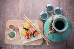 Japanese sushi and sake set. Japanese sushi set on old wood background Stock Photos