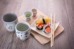 Japanese sushi and sake set. Japanese sushi set on old wood background Royalty Free Stock Photos