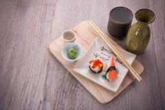 Japanese sushi and sake set. Japanese sushi set on old wood background Royalty Free Stock Images