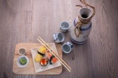 Japanese sushi and sake set. Japanese sushi set on old wood background Stock Images