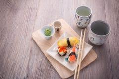 Japanese sushi and sake set. Japanese sushi set on old wood background Stock Photography