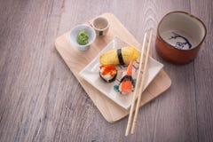Japanese sushi and sake set. Japanese sushi set on old wood background Royalty Free Stock Image
