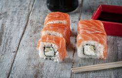 Japanese sushi with salmon avocado rice. royalty free stock photo