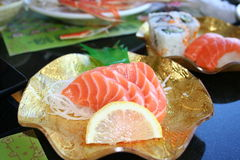 Japanese Sushi and Sashimi. Plates of Japanese sushi and sashimi served for lunch or dinner Stock Images