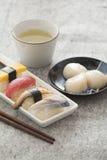 Japanese Sushi and Sashimi - Egg, Tuna, Eel, Swordfish, Jumbo S. Japanese Sushi and Sashimi -- Egg, Tuna, Eel, Swordfish, Jumbo Scallop, Green tea Royalty Free Stock Photo