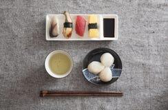 Japanese Sushi and Sashimi - Egg, Tuna, Eel, Swordfish, Scallop. Japanese Sushi and Sashimi -- Egg, Tuna, Eel, Swordfish, Scallop, Green tea Stock Image