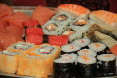 Japanese sushi. And sashimi, various sorts on a serving plate stock images