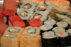 Japanese sushi. And sashimi, various sorts on a serving plate royalty free stock photos