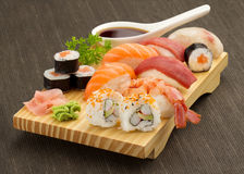 Japanese sushi. Japanese seafood sushi and maki on wooden plate Royalty Free Stock Images
