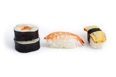 Japanese Sushi Set. Different types of sushes: Futomaki (big roll), Ebi (shrimp) and Tamago (cooked egg) isolated on white background Royalty Free Stock Image