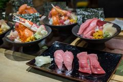 Variety of Japanese food set. Sushi and Donburi, Sashimi set for traditional food. Japanese Sushi Set including Salmon, Tuna, Shrimp, Salmon Roe, Sea Urchin and Royalty Free Stock Photos