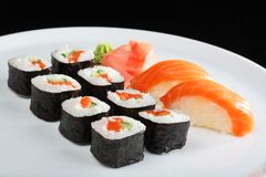 Japanese sushi set with salmon. Set of sushi and rolls with a salmon Stock Photography