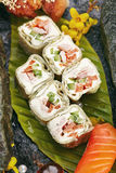 Japanese Sushi Set. Various Maki Sushi Roll and Nigiri Sushi. Japanese Cuisine and Natural Flower Concept Royalty Free Stock Photography